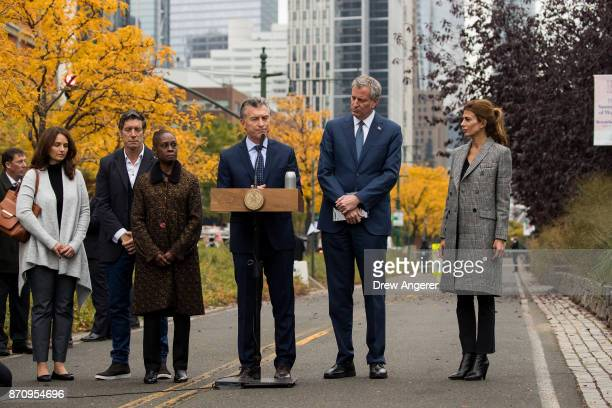 Flanked by Chirlane McCray and New York City Mayor Bill de Blasio Argentinian President Mauricio Macri pauses while speaking during a tribute for the...
