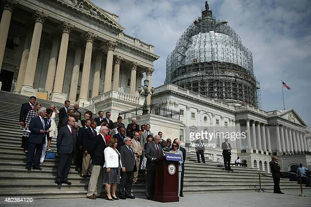 Flanked by Congressional members US House Democratic Whip Rep Steny Hoyer speaks during a rally in front of the US Capitol July 30 2015 on Capitol...