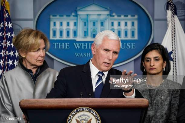 Flanked by Debbie Birx White House Corona Virus Response Coordinator and Seema Verma administrator of the Centers for Medicare and Medicaid Services...