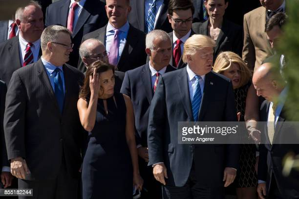 Flanked by Dina Powell Deputy National Security Advisor for Strategy and National Security Advisor HR McMaster President Donald Trump gets into place...