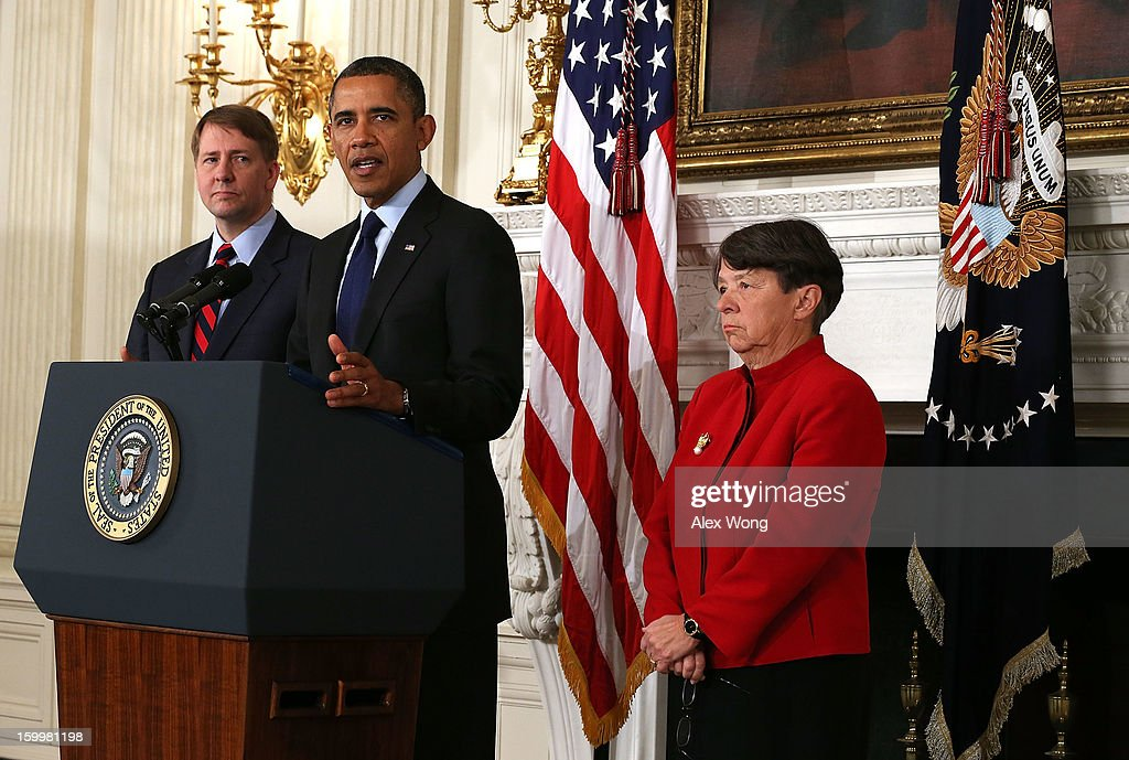 Flanked by Director of the United States Consumer Financial Protection Bureau Richard Cordray (L) and former U.S. Attorney for the Southern District of New York Mary Jo White (R) , U.S. President Barack Obama makes a personnel announcement at the State Dining Room of the White House January 24, 2013 in Washington, DC. President Obama nominated Mary Jo White to become the new Chairwoman of Securities and Exchange Commission. He also re-nominated Richard Cordray for the same position Cordray has been holding.