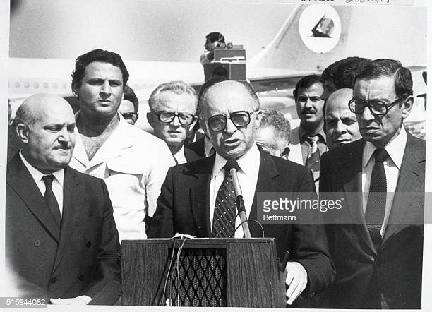 Flanked by Egyptian Foreign Minister Kemal Hassan Ali Israeli Prime Minister Menachen Begin gives a speech upon his arrival in Cairo for the funeral...