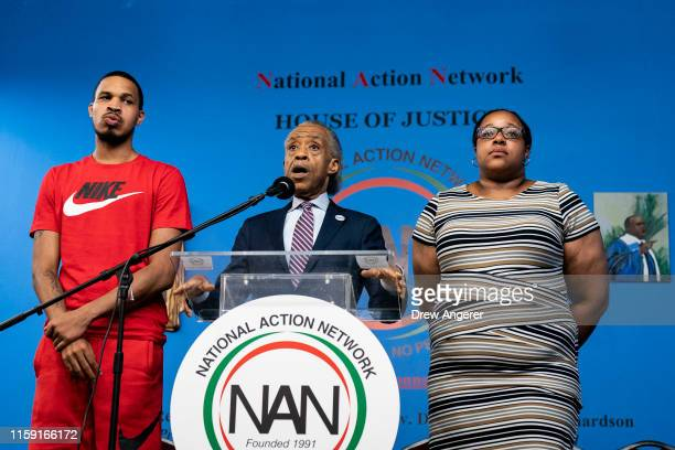 Flanked by Eric Garner Jr and Emerald Garner daughter of the late Eric Garner Rev Al Sharpton speaks during a press conference at the National Action...