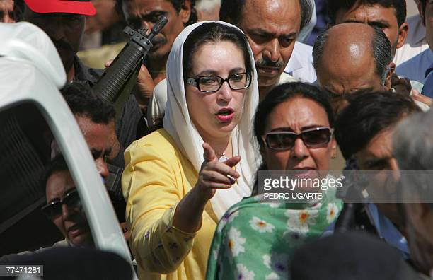 Flanked by heavy security carrying automatic weapons former Pakistani premier Benazir Bhutto boards her car in Karachi 21 October 2007 after a visit...