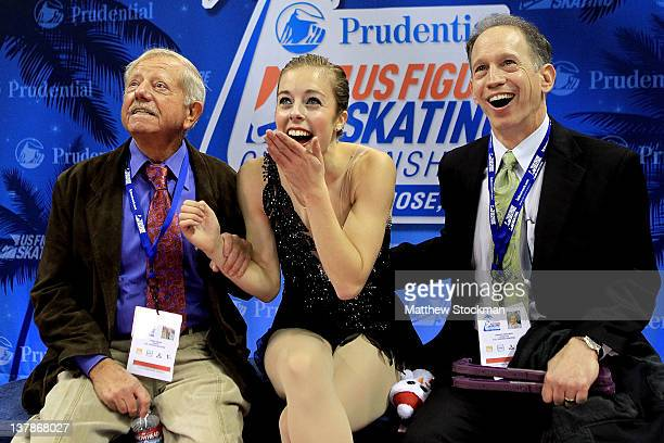 Flanked by her coaches John Nicks and Phillip Mills Ashley Wagner celebrates in the Kiss and Cry after competing in the Ladies Free Skate during the...
