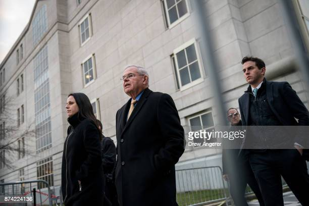 Flanked by his daughter Alicia and son Robert Jr Sen Robert 'Bob' Menendez departs federal court November 14 2017 in Newark New Jersey The jury...