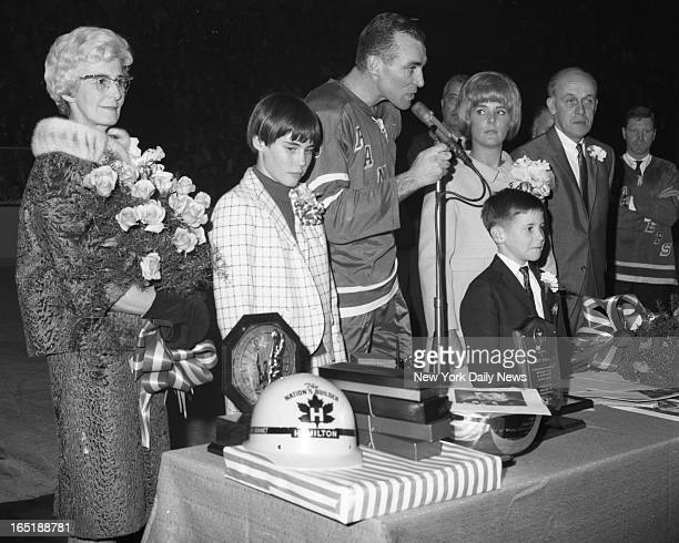 Flanked by his parents Mr and Mrs Vernon Howell and accompanied by his wife Marilyn and their children Cheryl and Danny veteran Ranger defenseman...