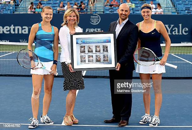 Flanked by Lucie Safarova and Petra Kvitova of the Czech Republic Anne Worcester tournament director of the New Haven Open at Yale is presented a...
