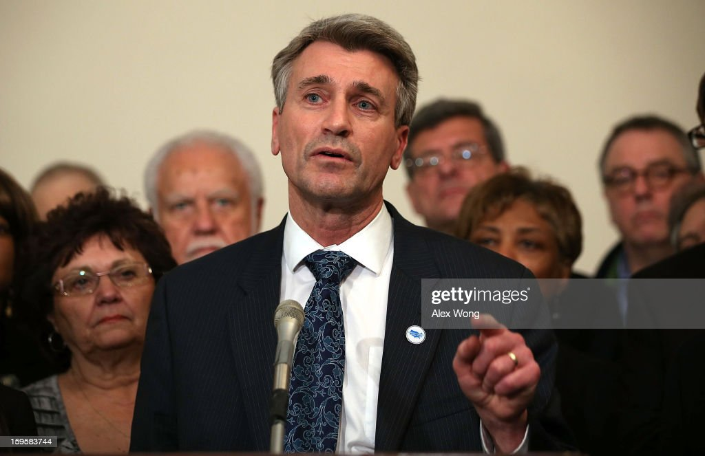 Flanked by mayors and gun control activists, Minneapolis Mayor R.T. Rybak (C) speaks during a news conference January 16, 2013 on Capitol Hill in Washington, DC. Members of Mayors Against Illegal Guns held a news conference to call on Congress to take action to end gun violence.