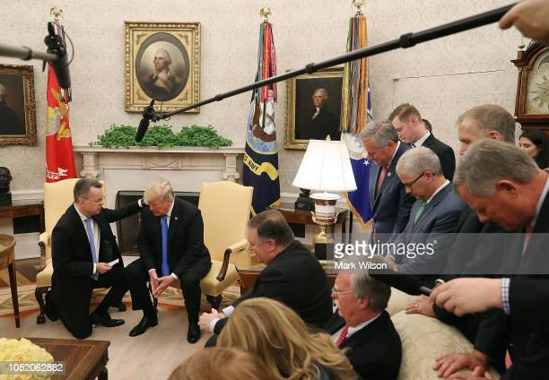 Flanked by members of Congress and administration officials US President Donald Trump and American evangelical Christian preacher Andrew Brunson...
