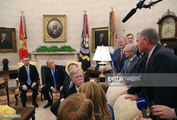Flanked by members of Congress and administration officials US President Donald Trump welcomes American evangelical Christian preacher Andrew Brunson...