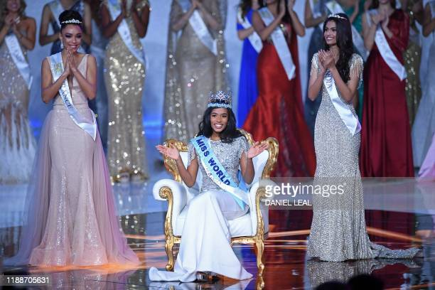 Flanked by Miss France Ophely Mezino and Miss India Suman Ratansingh Rao Miss World 2019 Miss Jamaica ToniAnn Singh waves to the crowd during the the...