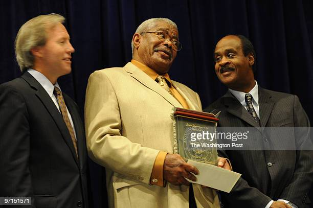 POST BETHESDA MD Flanked by Montgomery County Council President Phil Andrews left and County Executive Isiah Leggett Anthony Bruce is surprised at...