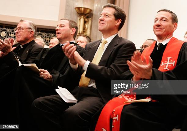 Flanked by National ProLife Action Center Director Paul Schenck and Rob Schenck of the National Clergy Council US Sen Sam Brownback attends a kick...
