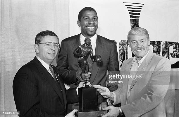 Flanked by NBA commissioner David Stern and Los Angeles Lakers' owner Jerry Buss Magic Johnson holds the NBA Most Valuable Player trophy for the 1987...