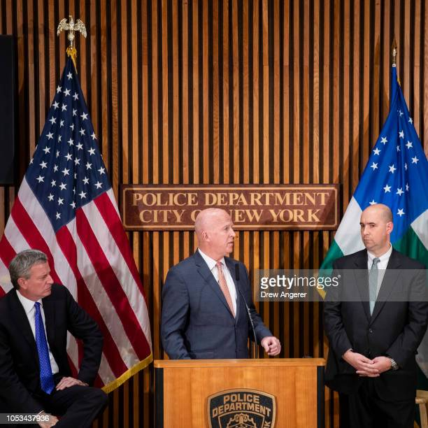 Flanked by New York City Mayor Bill de Blasio and William Sweeney assistant directorincharge of the New York office of the Federal Bureau of...