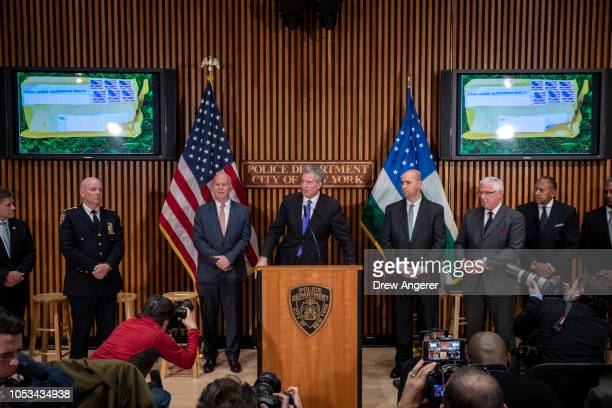 Flanked by New York City Police Commissioner James ONeill and William Sweeney assistant directorincharge of the New York office of the Federal Bureau...