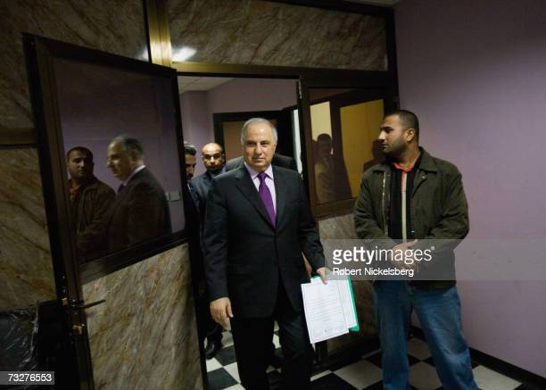 Flanked by one of his numerous bodyguards, former deputy prime minister Ahmad Chalabi walks into a meeting where he is chairman of the Committee of...