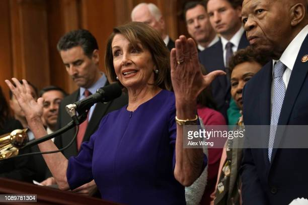 Flanked by other House Democrats US Speaker of the House Rep Nancy Pelosi speaks as Rep Elijah Cummings listens during a news conference at the US...