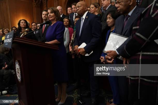 Flanked by other House Democrats US Speaker of the House Rep Nancy Pelosi speaks during a news conference at the US Capitol January 4 2019 in...