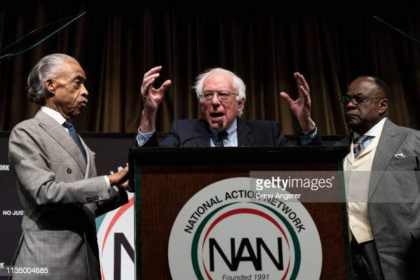 Flanked by Rev Al Sharpton and Rev W Franklyn Richardson look on as Democratic presidential candidate US Sen Bernie Sanders speaks at the National...