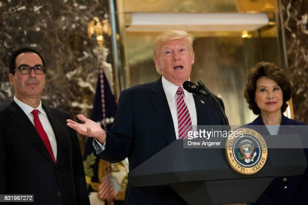 Flanked by Secretary of Treasury Steve Mnuchin and Transportation Secretary Elaine Chao US President Donald Trump delivers remarks following a...