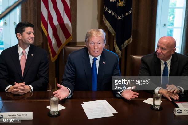 Flanked by Speaker of the House Paul Ryan and House Ways and Means Committee chairman Rep Kevin Brady President Donald Trump speaks about tax reform...