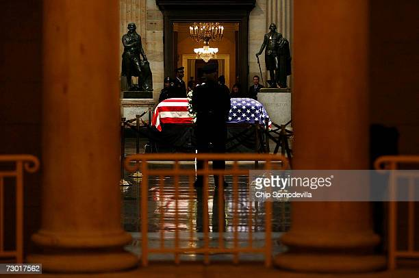 Flanked by statues of Thomas Jefferson and George Washington former US President Gerald Ford's remains lie in state in the Rotunda of the US Capitol...
