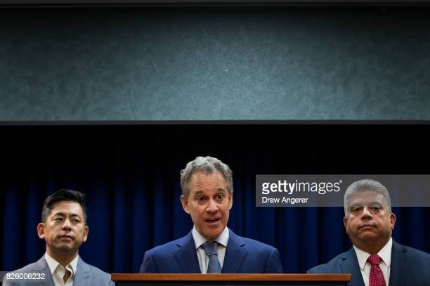Flanked by Steven Choi executive director of the New York Immigration Coalition and Acting Brooklyn Attorney General Eric Gonzalez New York State...