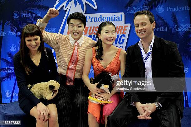 Flanked by their coaches Marina Zoueva and Igor Shpilband Alex Shibutyani and Maia Shibutani celebrate in the Kiss and Cry after the Free Dance...