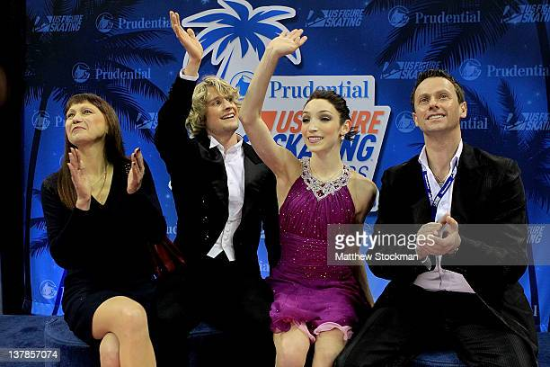 Flanked by their coaches Marina Zoueva and Igor Shpilband Charlie White and Meryl Davis celebrate in the Kiss and Cry after the Free Dance during the...