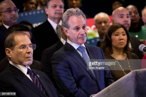Flanked by US Rep Jerrold Nadler and US Rep Grace Meng New York Attorney General Eric Schneiderman takes questions from the media at a press...