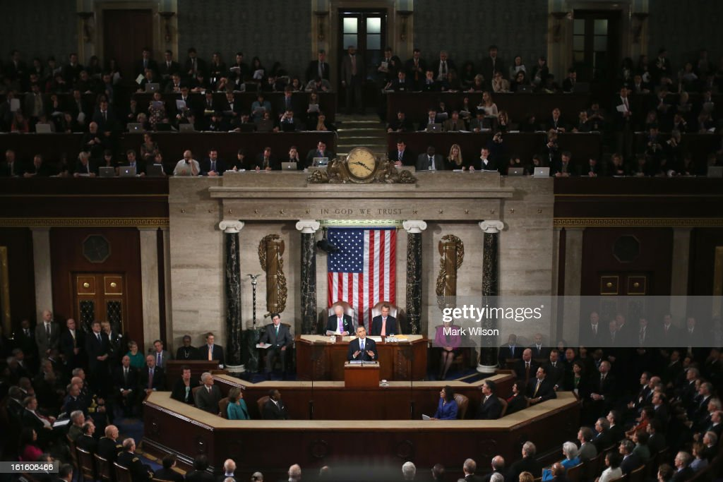 Flanked by U.S. Vice President Joe Biden (L) and Speaker of the House John Boehner (R), U.S. President Barack Obama (C) delivers his State of the Union speech before a joint session of Congress at the U.S. Capitol February 12, 2013 in Washington, DC. Facing a divided Congress, Obama concentrated his speech on new initiatives designed to stimulate the U.S. economy and said, 'It's not a bigger government we need, but a smarter government that sets priorities and invests in broad-based growth'.
