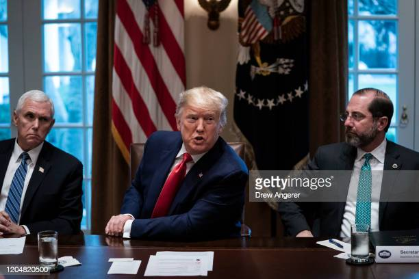 Flanked by U.S. Vice President Mike Pence and Secretary of Health and Human Services Alex Azar, U.S. President Donald Trump speaks during a meeting...
