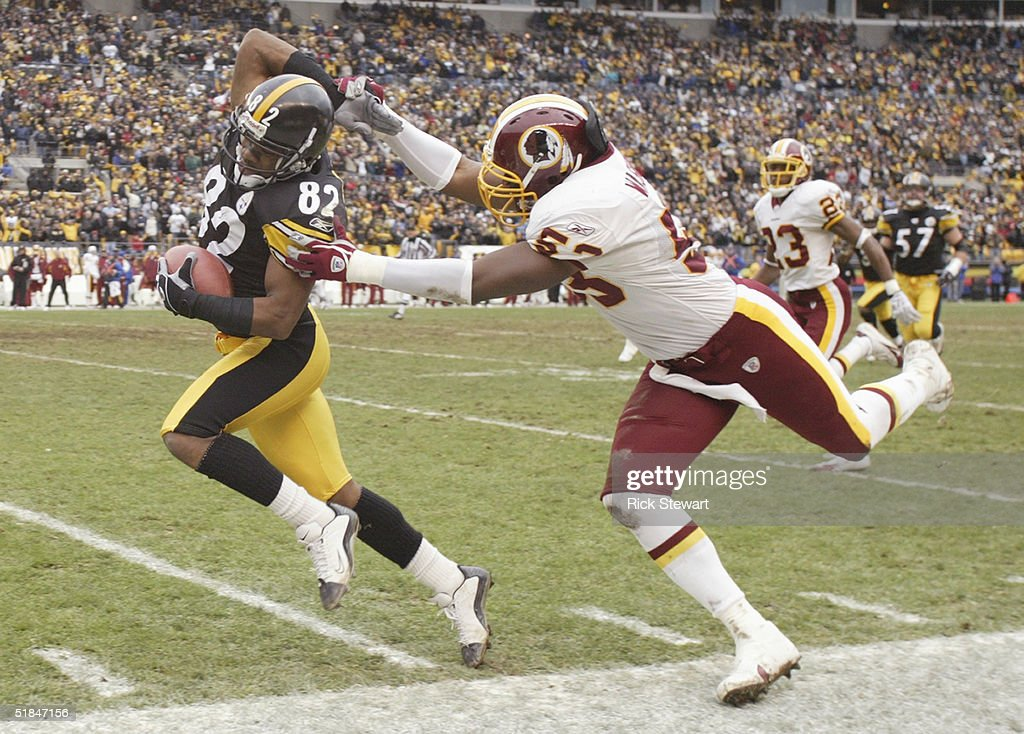 Flanker Antwaan Randle El #82 of the Pittsburgh Steelers evades linebacker Marcus Washington #53 of the Washington Redskins during the game on November 28, 2004 at Heinz Field in Pittsburgh, Pennsylvania. The Steelers defeated the Redskins 16-7.