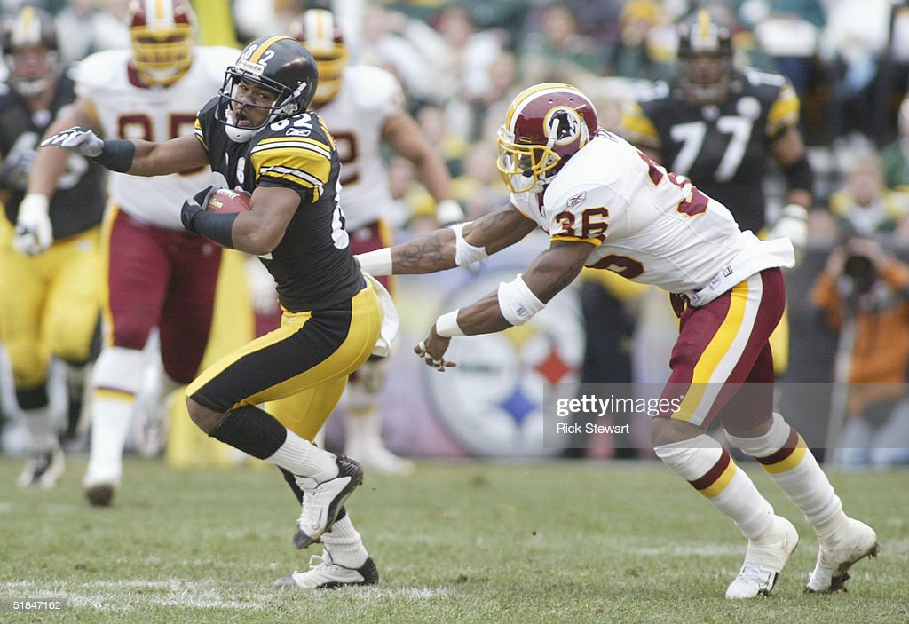 Flanker Antwaan Randle El #82 of the Pittsburgh Steelers is tackled by safety Sean Taylor #36 of the Washington Redskins during the game on November 28, 2004 at Heinz Field in Pittsburgh, Pennsylvania. The Steelers defeated the Redskins 16-7.