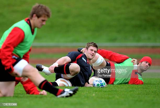 Flanker Dan Lydiate stretches with teammates during a Wales IRB Rugby World Cup 2011 training session at Newtown Park on October 6 2011 in Wellington...