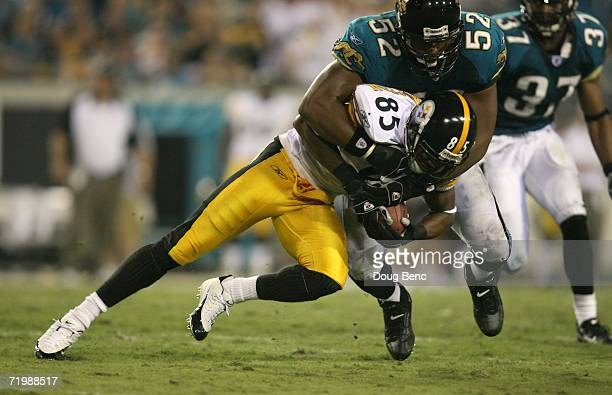 Flanker Nate Washington of the Pittsburgh Steelers is tackled by linebacker Daryl Smith of the Jacksonville Jaguars during the game at Alltel Stadium...