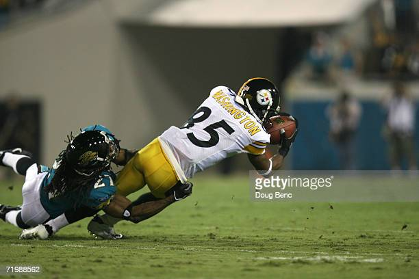 Flanker Nate Washington of the Pittsburgh Steelers is tackled by cornerback Rashean Mathis of the Jacksonville Jaguars during the game at Alltel...