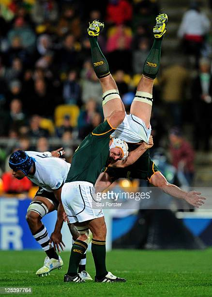 Flanker Schalk Burger of the Springboks is upended at a restart despite the supoport from teammate Heinrich Brussow during the IRB 2011 Rugby World...
