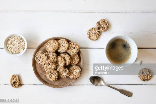 flapjacks and cup of black coffee - biscuit stock photos and pictures