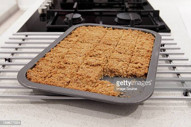 flapjacks in a tray - esher stock pictures, royalty-free photos & images