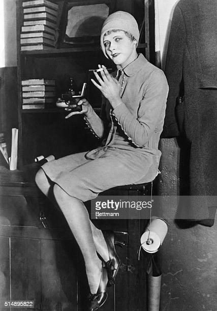 Flapper sitting on a desk smoking Undated photograph ca 1920's