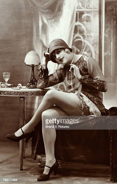 Flapper with legs crossed