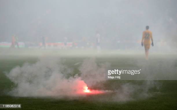 A flare is seen on the pitch during the Bundesliga match between 1 FC Union Berlin and Hertha BSC at Stadion An der Alten Foersterei on November 02...