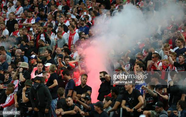 A flare is set off by the Ajax fans during the UEFA Europa League Final match between Ajax and Manchester United at Friends Arena on May 24 2017 in...