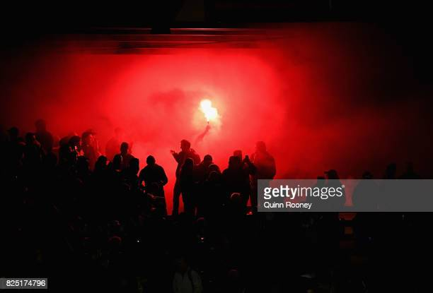 A flare is set off during the FFA Cup round of 32 match between Heidelberg United FC and Perth Glory at Olympic Park on August 1 2017 in Melbourne...