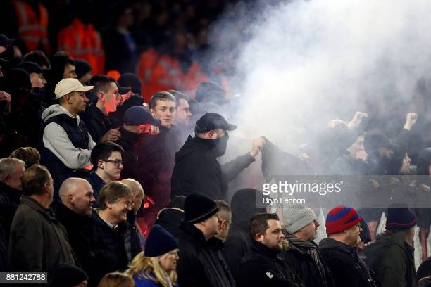 A flare is set off during the Premier League match between Brighton and Hove Albion and Crystal Palace at Amex Stadium on November 28 2017 in...