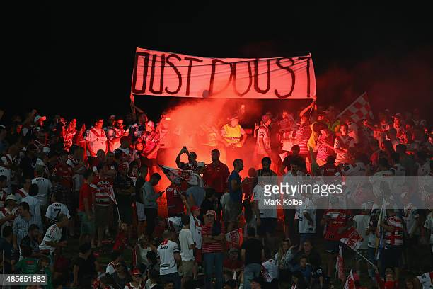 A flare is set off in the crowd during the round one NRL match between the St George Illawarra Dragons and the Melbourne Storm at WIN Jubilee Stadium...