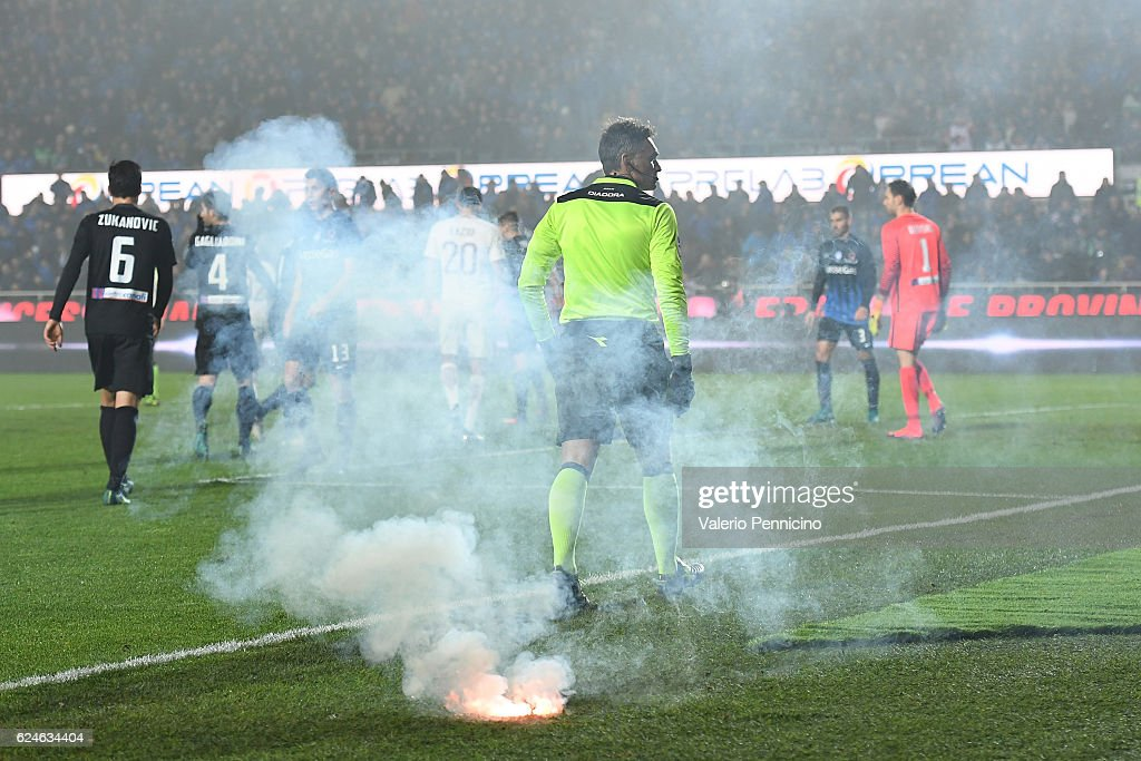 A flare launched by supporters of AS Roma lies on the ground during the Serie A match between Atalanta BC and AS Roma at Stadio Atleti Azzurri d'Italia on November 20, 2016 in Bergamo, Italy.
